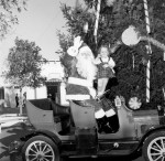 Santa and friend on Antique Car Ride